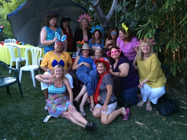 Jeri Buliavac is surrounding by her exercise group the Dirty Divas at her 50th birthday party. Instead of gifts, guests made donations to Family Service Agency. (Photo by Lexi Buliavac)
