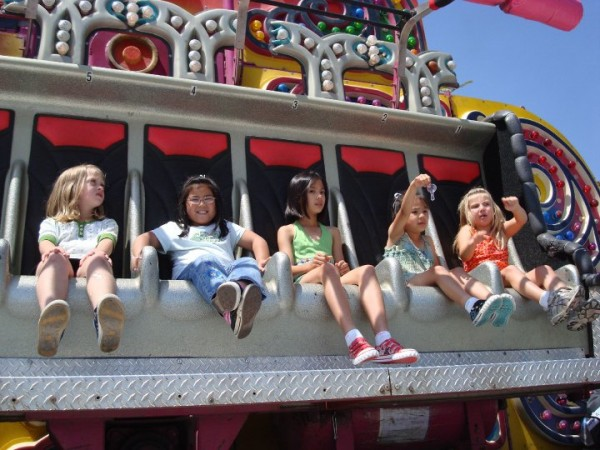 Children enjoy a ride at the Old Tyme Country Faire. (Photo Courtesy of St. Francis Xavier Catholic Church)