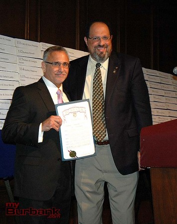 JC Holt, left, Burbank Community YMCA chief executive officer, receives a proclamation from Burbank Mayor David Gordon during the Burbank Noon Kiwanis Gala on Saturday night at Lakeside Golf Club. (Photo by Joyce Rudolph)