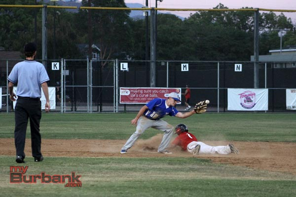 Tanner Whitlock dives in safely at second base (Photo by Ross A. Benson)