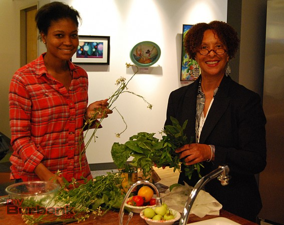 (from left to right) Cartoon Network's Alexandria Taylor and Linda Barry wash some fresh vegetables and herbs. (Photo By Lisa Paredes)