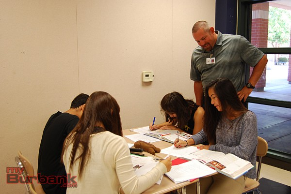 TOSA Kenneth Knoop check a student's homework during class at Options For Youth's Summer Program at Burbank High.  (Photo By Lisa Paredes)