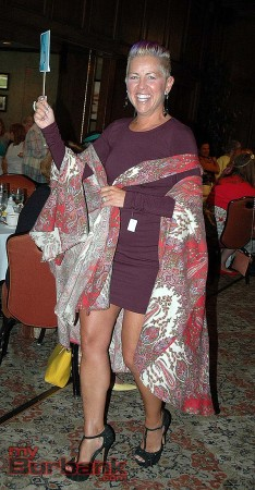 Sandra Kelley models a dress and cape from the La Providencia Guild of Children's Hospital Thrift Shop during the Summer Meeting. (Photo by Joyce Rudolph)