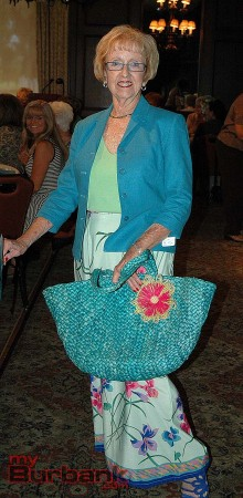 Lynn White-Shelby found a beautiful turquoise jacket to wear over a floral skirt along with coordinating straw bag and shoes. (Photo by Joyce Rudolph)