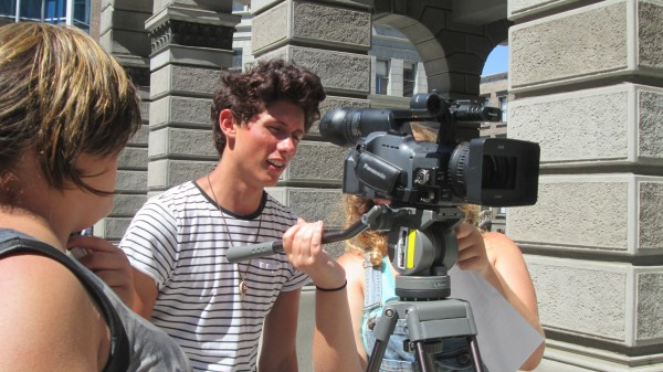 Brennan Flynn peeks through the camera. (Photo Courtesy of Young Storytellers Foundation)