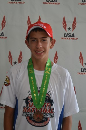 Alexander Hirsch proudly wears his 5th place medal at JOs (Photo courtesy of Charles Hirsch)