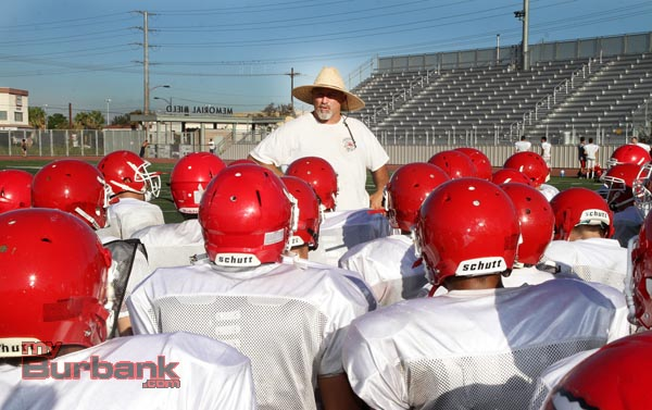 Coach Keith Knoop speaks to his team about possessing a blue collar mentality (Photo by Ross A. Benson)