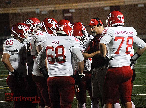 Coach Keith Knoop speaks with his team during Friday night's tilt vs. Crescenta Valley (Photo by Craig Sherwood)