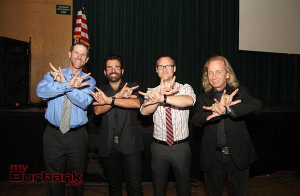 "Using sign language to say ""superhero"" are (left to right) Principal Dr. Greg Miller, John Maucere, Daniel Swartz and Paul Raci. (Photo by Ross A. Benson)"