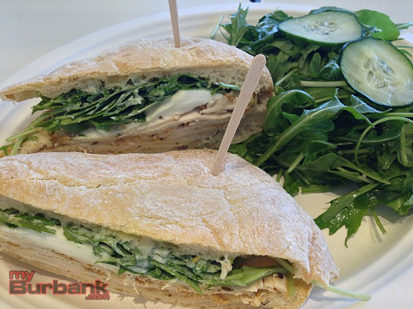 Herb Grilled Chicken sandwich with mozzarella, basil pesto and arugula at Lemonade. (Photo By Lisa Paredes)