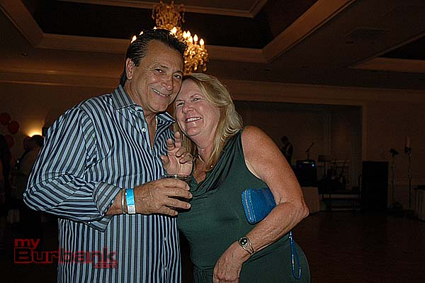 Mike Signorelli, Burbank High Class of '72, with Mary Rutherford, Burbank High '73, at the JBHS-BHS All-Class Reunion Saturday night at the Castaway Restaurant. (Photo by Joyce Rudolph)