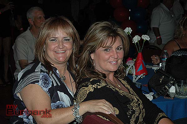 Cousins Susan Pena MacCaskey, left, BHS '75, and Cheree Clark Border, BHS '76, attend the all-class reunion on Saturday night at the Castaway Restaurant. (Photo by Joyce Rudolph)