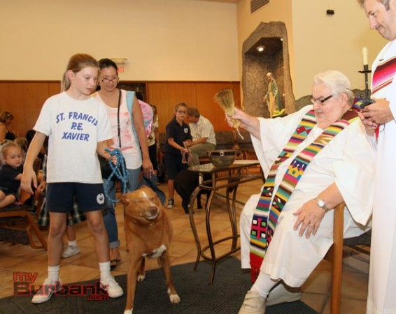 Pets love to shake off the water sprinkled on them during the Blessing of the Animals at St. Francisc Xavier. ( Photo by Ross A. Benson)