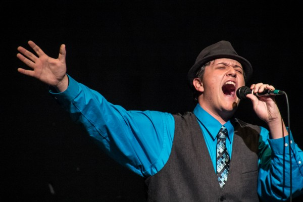 "Miles Gonzalez engages the crowd with ""Dentist"" from ""Little Shop of Horrors."" (Photo Courtesy of Kathy Flynn)"