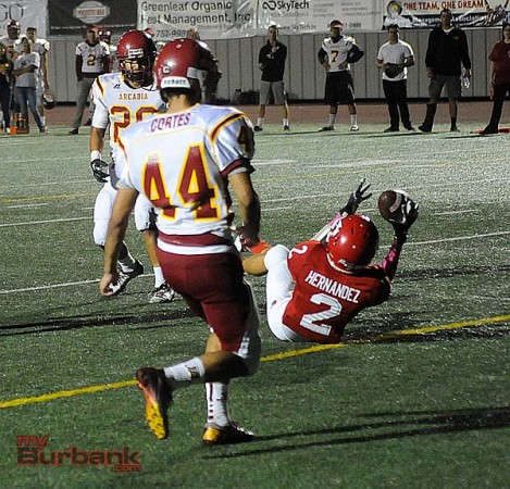 Erick Hernandez snags one of his three touchdowns on the evening (Photo by Craig Sherwood)