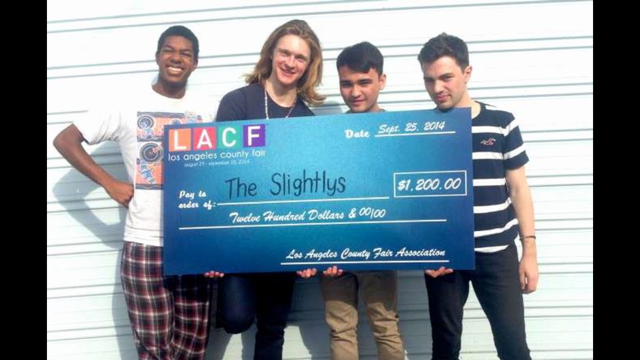 Dudley, O'Connell, Fitzpatrick and Marinelli hold giant winning check LA County Fair Award Ceremony