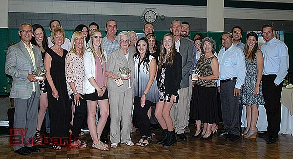 "The Clarke, Machuca Vargas and Vander Borght family receives the Mary Alice O'Connor Vision Award at the Family Service Agency's ""Imagine a City"" dinner on Saturday night at Providence High School gymnasium. (Photo by Joyce Rudolph)"