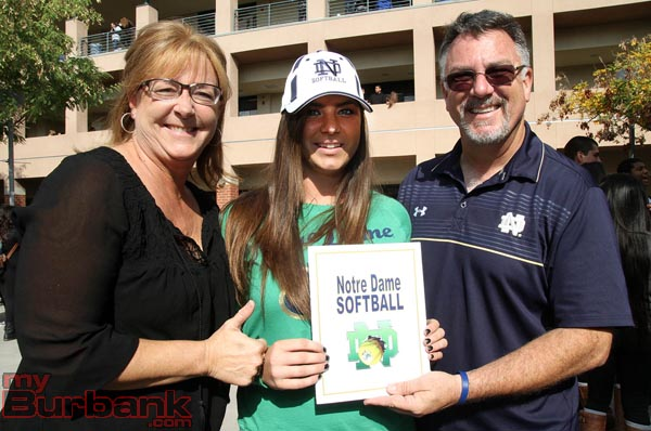 Alongside her mom and dad, Caitlyn Brooks signed with the University of Notre Dame and is considered one of the top softball players in the country (Photo by Ross A. Benson)