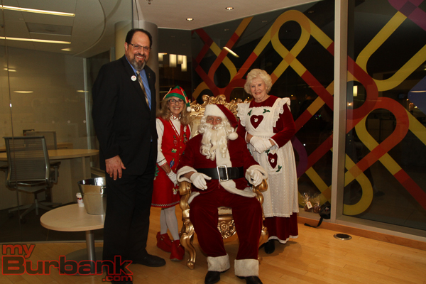 Burbank Mayor Dr. David Gordon with a Christmas Elf, Santa and Mrs. Claus. (Photo by Ross A. Benson)