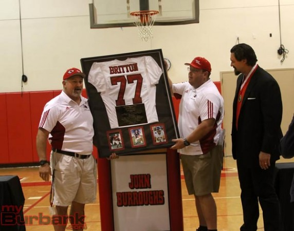 Coach Keith Knoop (left) and Coach Mike Reilly present Eben Britton with his retired jersey (Photo by Ross A. Benson)