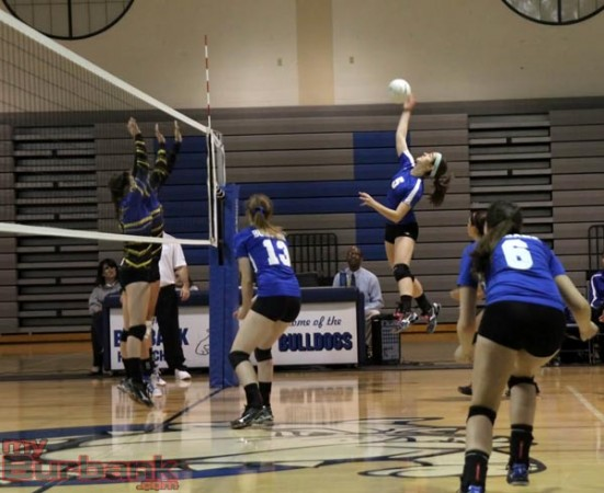 Burbank's Denise Daniel goes high for a kill in the Bulldog's win (Photo by Ross A. Benson)