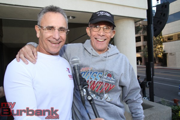 YMCA CEO J.C. Holt is joined by Mickey DePalo run announcer.(Photo by Ross A. Benson)