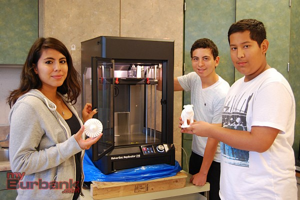Burbank High School art students (from left to right), eleventh-grader Lizbeth Najera, twelvth-grader Mark Gonzalez and tenth-grader Storm Lamoureaux, show some of the pieces created with the school's 3D printer. (Photo By Lisa Paredes)