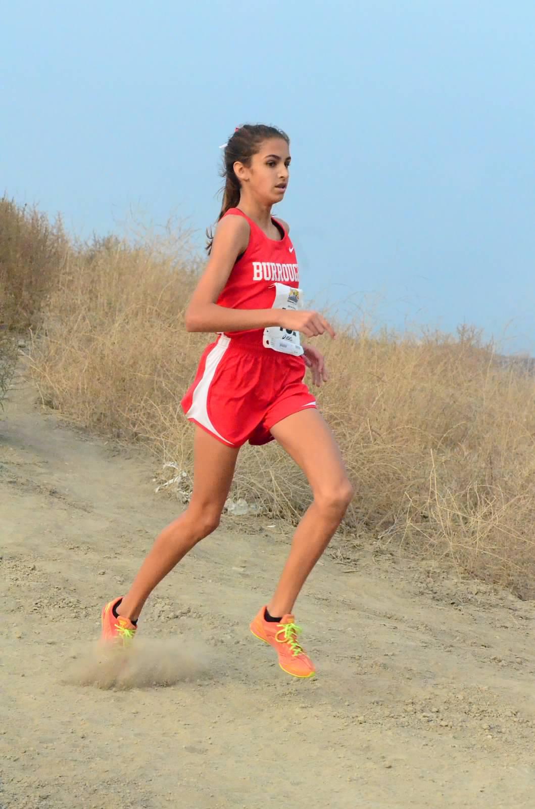 John Burroughs High School's Emily Virtue runs a cross-country terrain course. (Photo Courtesy of Oscar Eligio)