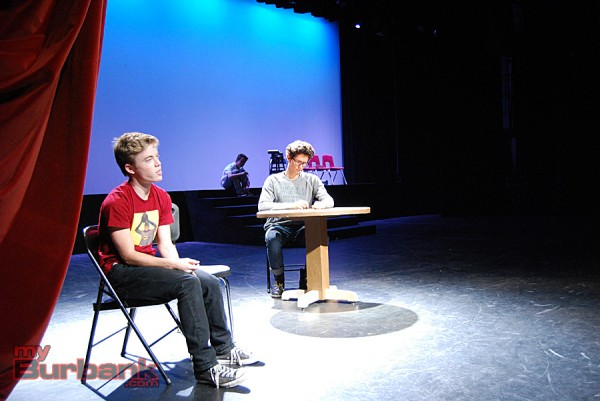 "Burroughs junior Nick Apostolina rehearses a scene from ""Flowers For Algernon"" with Brennan Flynn while Christopher Spencer waits in the background for a flashback scene. (Photo By Lisa Paredes)"