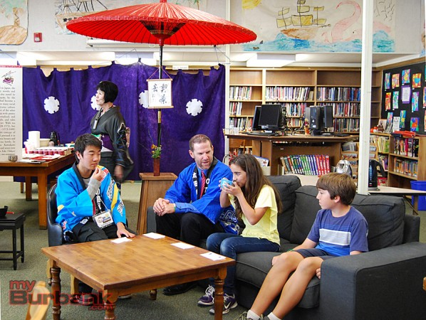 Yuito Miyazaki from Rebun, Japan, joins Muir Principal Dr. Greg Miller, Muir student Sona Abrahamyan and Dylan Giliberto for the Japanese Tea Ceremony. (Photo By Lisa Paredes)