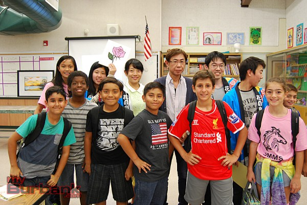 John Muir Middle School students join Japanese students from Rebun, Japan, and Kyrie artist Kiyoto Kuge in an art class. Back row (from right to left): Yuito Miyazaki, teacher Sho Itabashi, artist Kiyoto Kuge, Rei Sato and Nagomi Sasamori. (Photo By Lisa Paredes)