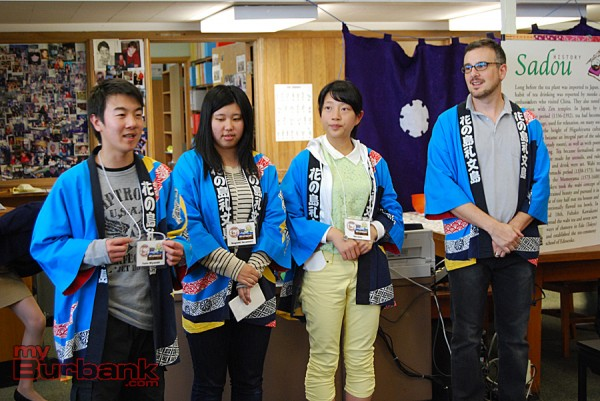 Yuito Miyazaki, Nagomi Sasamori and Rei Sato from Rebun, Japan, are introduced to Muir Middle School students by teacher Ted DeVirgilis (from left to right.) (Photo By Lisa Paredes)