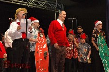 "Mark Nakamura, left, and Ernie Pistacchio, at the microphones, lead clients in ""O Holy Night"" during the Holiday Program presented by BCR ""a place to grow"". (Photo by Joyce Rudolph)"