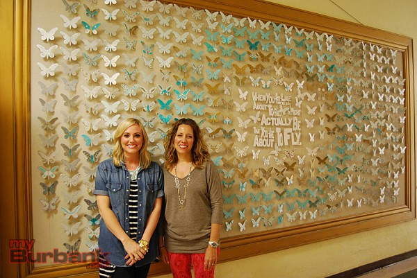 Shauna Funk (left) and Kristen Gara coordinated and installed the giant art project, comprised of hundreds of individual butterflies, in the main hallway of Roosevelt Elementary School. (Photo By Lisa Paredes)