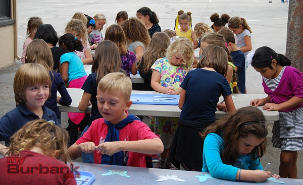 Roosevelt Elementary first-graders color butterflies for a school-wide art project.(Photo By Lisa Paredes)