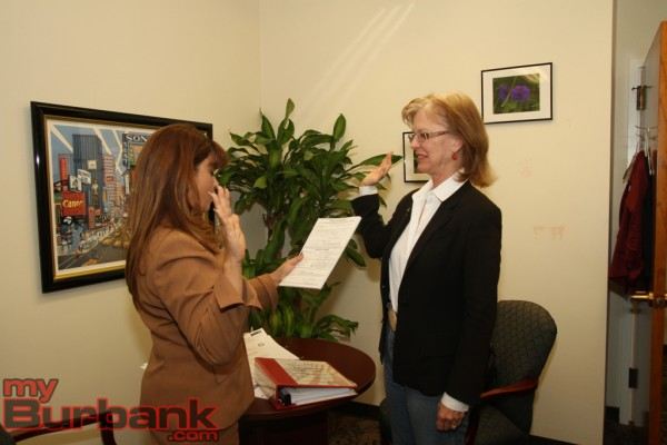 Burbank City Clerk Zizette Mullins gives the only incumbent Emily Gabel-Luddy who has filed papers the oath of election code of ethics. ( Photo by Ross A. Benson)