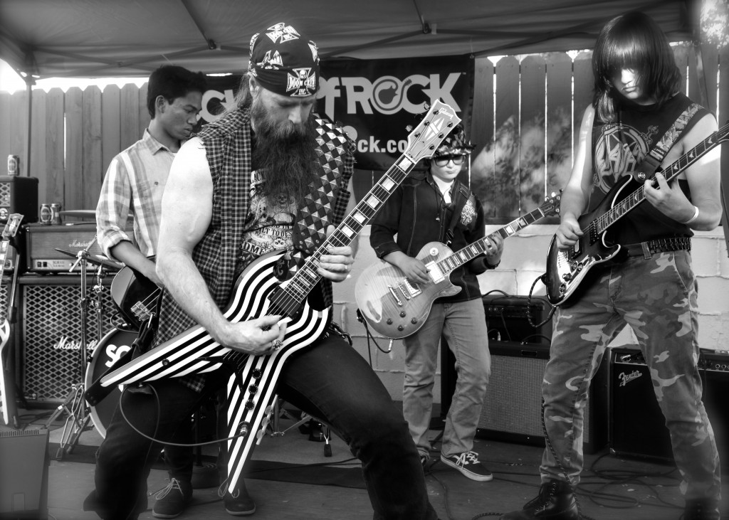 (from left to right) Daniel Alcala, Bennett Walker and Jerod Salomon rock out with heavy metal guitarist Zakk Wylde (foreground) at the School of Rock Burbank. (Photo Courtesy of Dana Hesse/School of Rock Burbank)