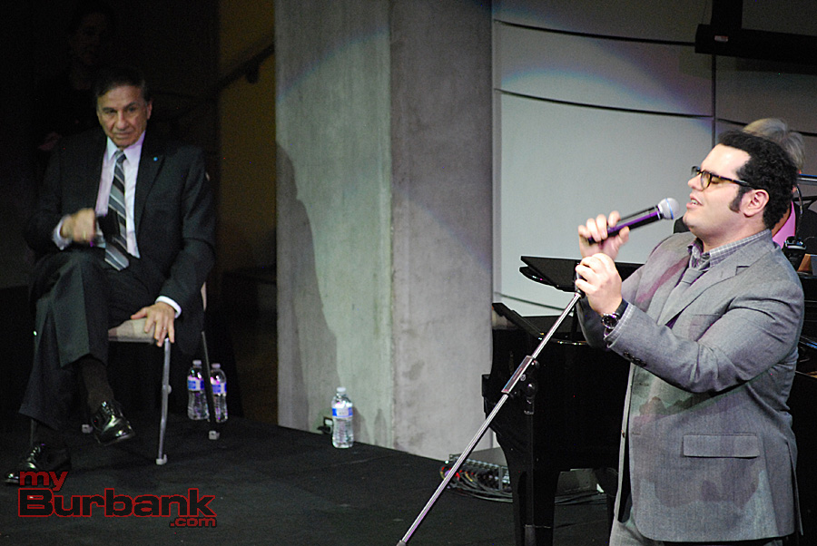 """Actor Josh Gad sings """"I Wanna Be Like You"""" from The Jungle Book to the song's composer/lyricist Richard M. Sherman at the Education Through Music - LA gala. (Photo By Lisa Paredes)"""