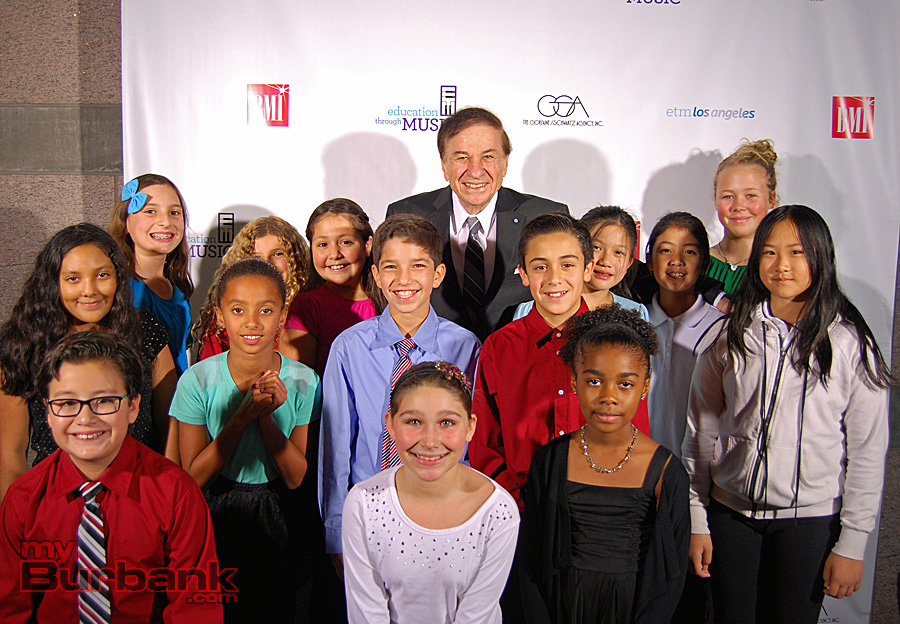 Academy Award-winning composer Richard M. Sherman with a group of Burbank and Los Angeles schoolchildren on the Education Through Music- LA red carpet. (Photo By Lisa Paredes)
