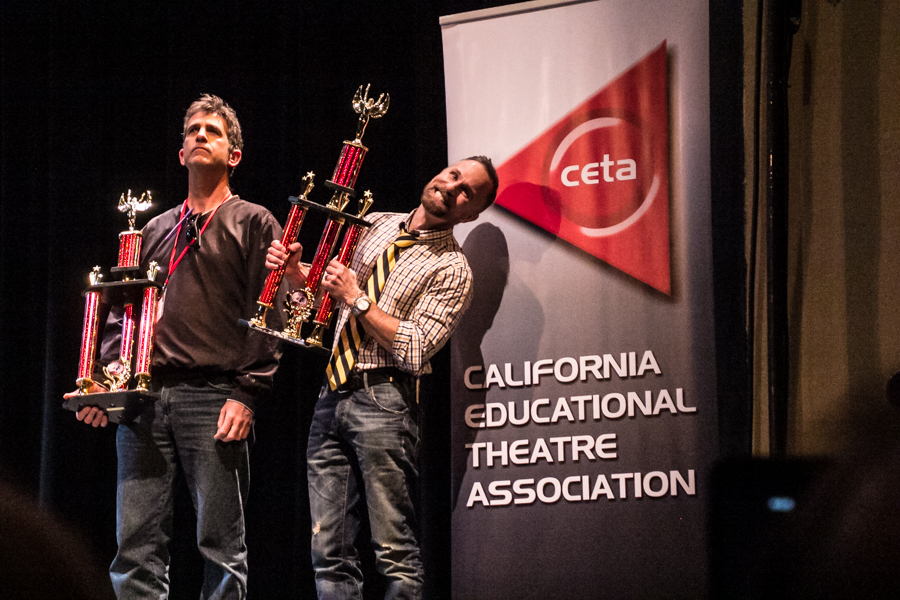"""JBHS Drama teacher Guy Myers (center) with his best drama trophy for """"Flowers For Algernon."""" (Photo Courtesy Kathy Flynn/Wicked Goddess Photography)"""
