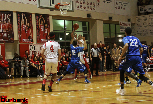 Steven Hubbell scores two of his game-high 21 points in the win against Burbank (Photo by Ross A. Benson)