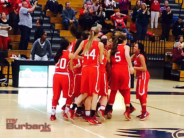 The Lady Indians celebrate their 19th straight win (Photo by Dick Dornan)