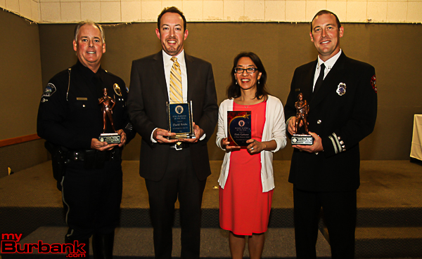 Community Service Honorees( from left to right) police officer Tim Dyrness ,city employee David Kriske, teacher Darla Gerharter and firefighter Erik Juedan. (Photo by Ross A. Benson)