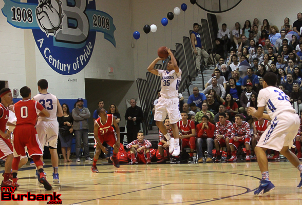 Burbank's Ben Chavez fires a three in the win against Burroughs (Photo by Ross A. Benson)