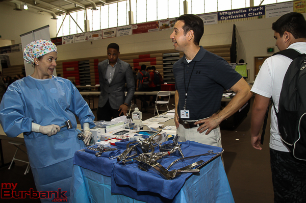 Michele Rose Porter of Concorde Career College show how a hip replacement is done. (Photo by Ross A. Benson)