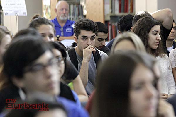 Aven Misiryan listens as Schiff talks about the Armenian Genocide (Photo By Edward Tovmassian)