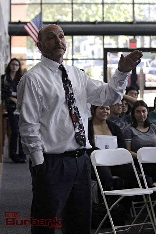 Government Teacher Richard Sarquiz asks Schiff to give his students some wise advise (Photo By Edward Tovmassian)
