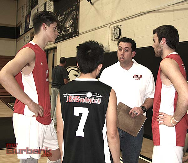Coach Joel Brinton speaks to his team prior to the pivotal third set (Photo by Dick Dornan)