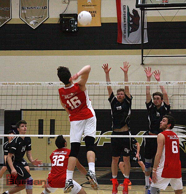 Cameron Capili records a kill against Oak Park (Photo by Dick Dornan)