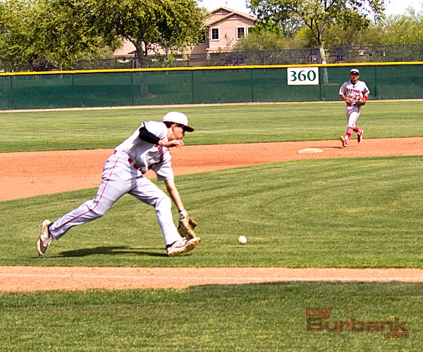 Brennan Brown fields a ground ball vs. Sheldon (Photo courtesy of Ivan Galan)